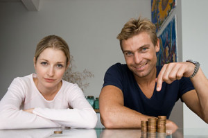 Couple with pile of coins